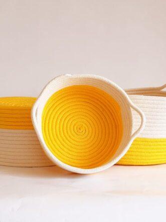 set of yellow cotton silk baskets